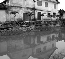 Old building next to the Japanese bridge in Hoi An by mechelle142