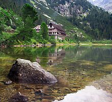 Chalet Reflection off Lake by Subterfuge