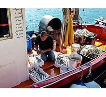 fisherman preparing catch Photographic Print