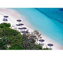 Sun umbrellas dotted along the white sand beach Photographic Print
