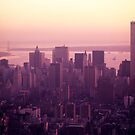 Foggy cityscape at sunset, Manhattan, New York, USA. by Sami Sarkis