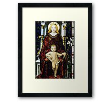 Stained glass window of the Madonna and Child Framed Print