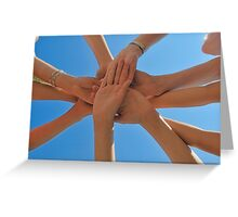 Six people stacking their hands on blue sky Greeting Card