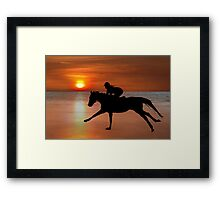 silhouette of a horse and rider galloping on beach Framed Print