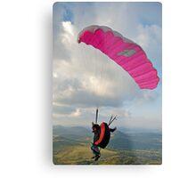 Man paragliding off hill Metal Print