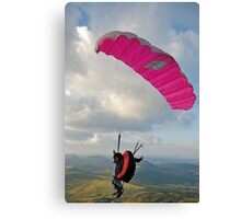 Man paragliding off hill Canvas Print