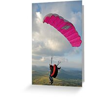 Man paragliding off hill Greeting Card
