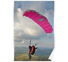 Man paragliding off hill Poster