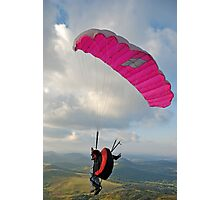 Man paragliding off hill Photographic Print