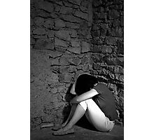 Depressed woman sitting with head in hands in a room corner  Photographic Print