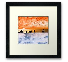 silhouette of people on the cliff edge above clouds Framed Print