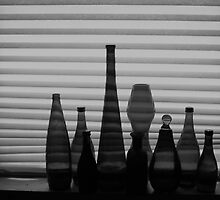 Bottles on the shelf by peterrobinsonjr