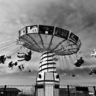 Carnival ride - Chicago, USA by Norman Repacholi
