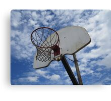 Basketball Hoop against Blue Sky Canvas Print