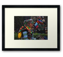 H'mong woman taking a break after a hard day selling her trinkets Framed Print