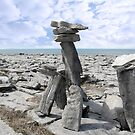 standing boulders in rocky burren landscape by morrbyte