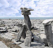 standing boulders in rocky burren landscape by morrbyte