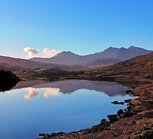 Winter sunshine reflects Snowdon. by vonniepyn