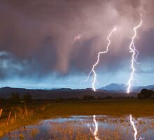 Lightning Striking Longs Peak Foothills by Bo Insogna