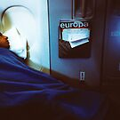 sleeping man in the plane by busteradams