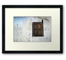 A lonely window Framed Print