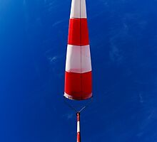 Windsock against blue sky by Sami Sarkis