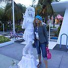 the statue and my friend Nel by Lazarita Betancourt