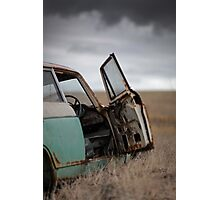 Abandoned car in field Photographic Print