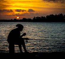 A lonely fisherman at sunset by Nobby31