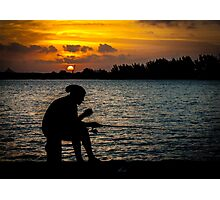 A lonely fisherman at sunset Photographic Print