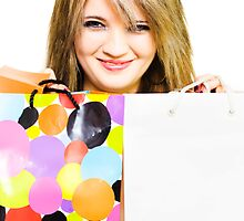 Happy smiling woman holding shopping bags by Ryan Jorgensen