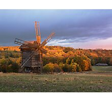 Old wooden windmill in autumn evening. Ukraine, Pyrohiv Museum.  Photographic Print