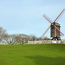 Windmill at the park in Bruges, Belgium by kirilart