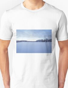 As snow covers the land T-Shirt