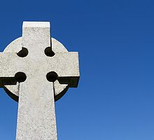 Celtic Stone Cross against a deep blue sky by Kenneth Keifer