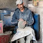 Sanding the Plates, Pottery Plant Fes Morocco by Debbie Pinard