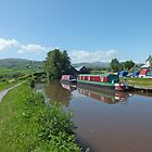 Boats on the Brecon to Monmouthshire canal with the Brecon Beacons in the back ground. by Robert Lewis