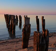 Sunset over an old pier by jessunderwater