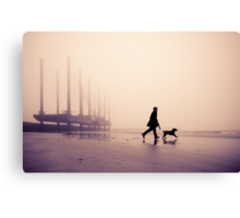 Man and Labrador on the beach at Newhaven, East Sussex Canvas Print