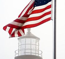 US Flag and Portland Head Light, Maine by Kenneth Keifer