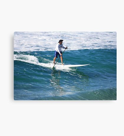 A Man & His Paddle Canvas Print