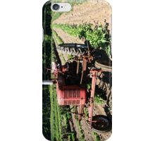 An Old Tractor in a Field iPhone Case/Skin