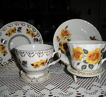 tea Cups With Pretty yellow Flowers On Them by ack1128