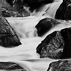 Running water and rocks by bluetaipan