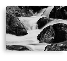 Running water and rocks Canvas Print
