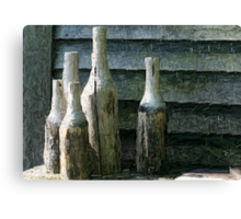 5 Bottles of Wood on the Wall Canvas Print