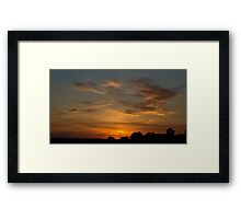 Charging the Sunset Framed Print