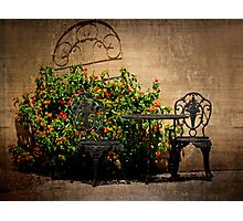 Table and Chairs in Black With Flowers Photographic Print