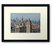Aerial view of Manhattan buildings from Wall street building rooftop Framed Print
