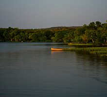 Canoe on lake by NewLayer